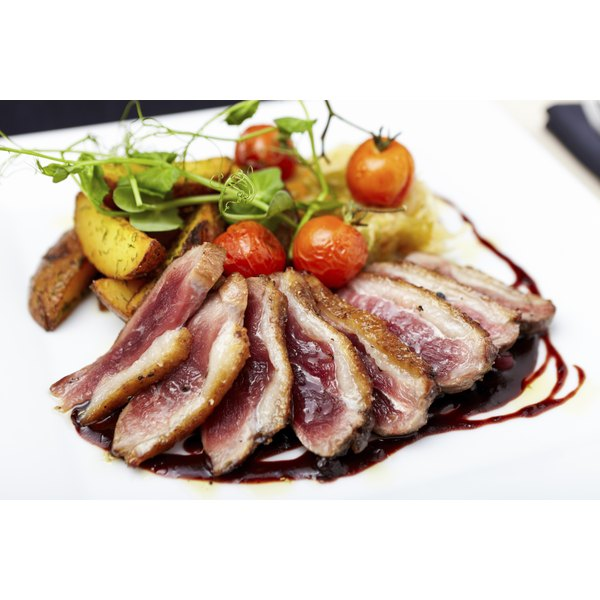 Roasted duck breast with cherry tomatoes.