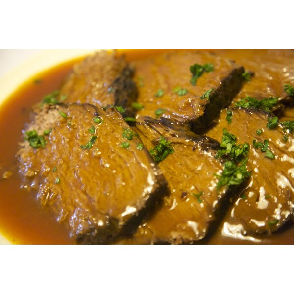 Homemade gravy tops sliced beef sirloin tip roast.
