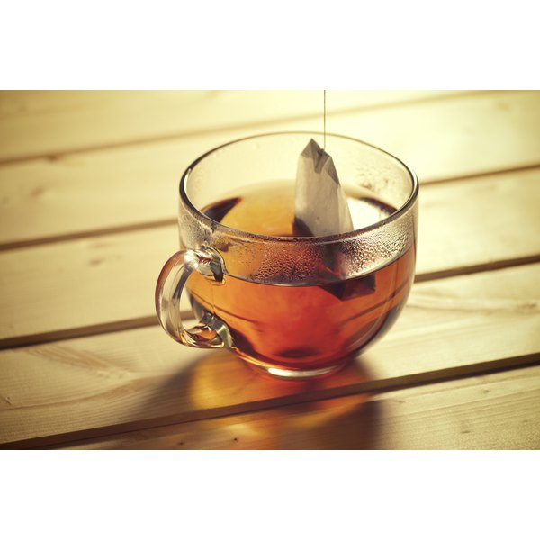 A Teabag Being Brewed In Cup Of Hot Water