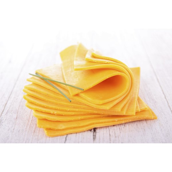 Sliced cheese on a table.