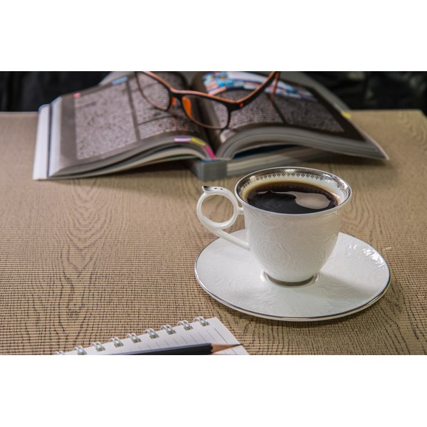 A cup of black coffee on a table.