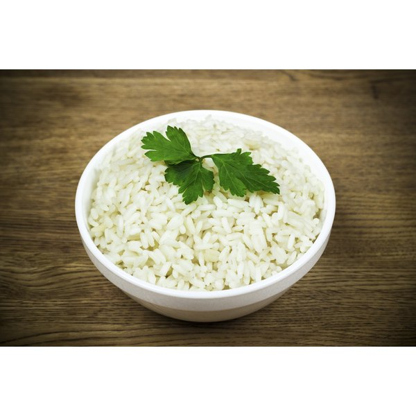 A bowl of rice with a garnish of parsley.