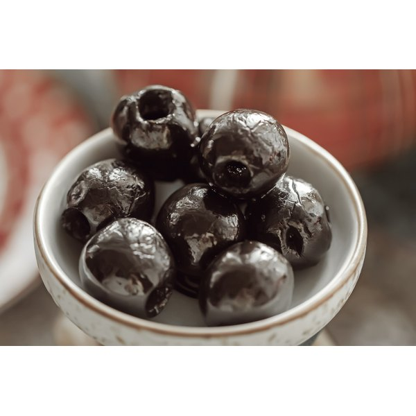 Black olives in a small bowl.