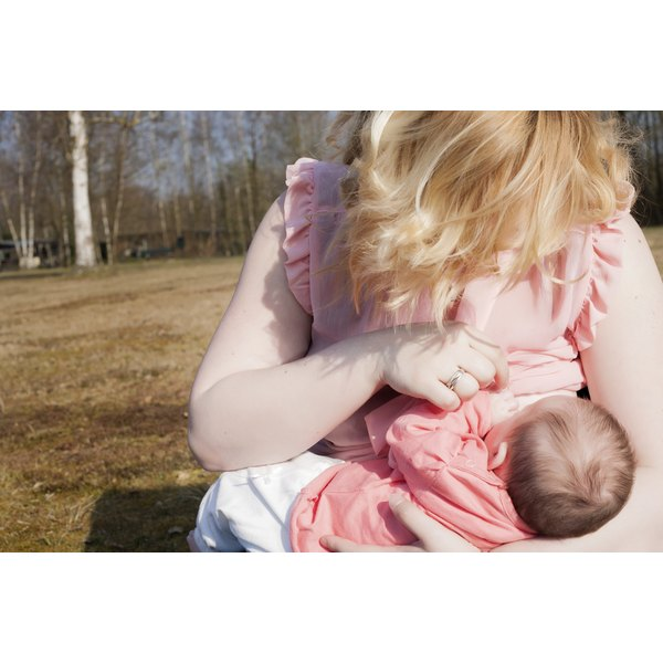 A woman breastfeeding her baby.