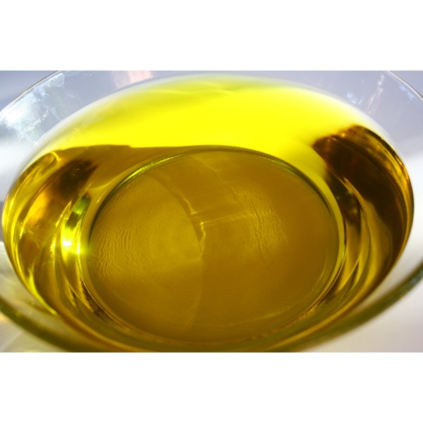 Olive oil in a glass bowl.