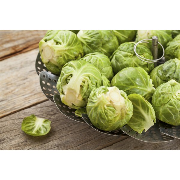 Brussels sprouts in a steamer basket.