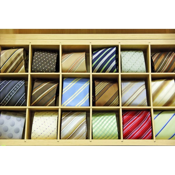 Silk ties for sale at a shop.