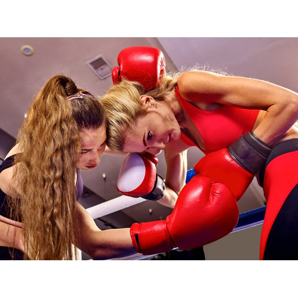 Two women are in a boxing ring.