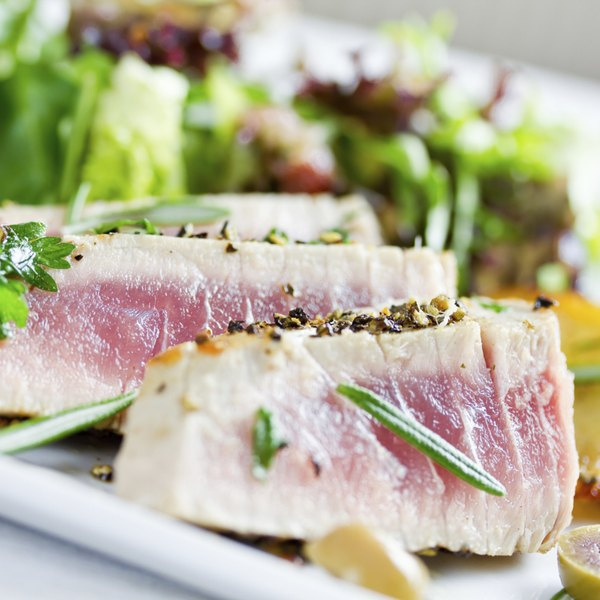 A plate of lightly grilled tuna and salad