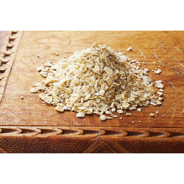 Rolled oats on a cutting board.