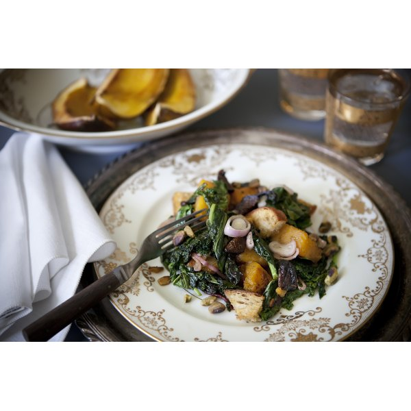 A warm squash salad with wilted spinach.