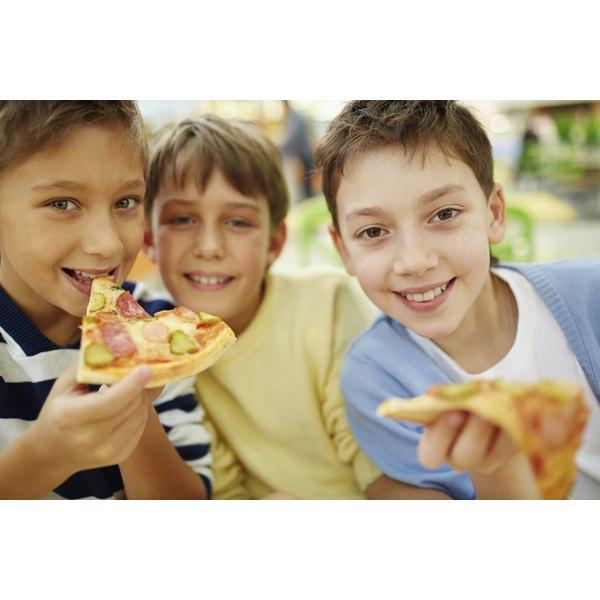 Children enjoy having some pizza.