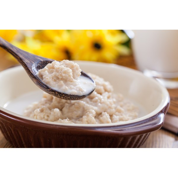 A bowl of oatmeal with milk.