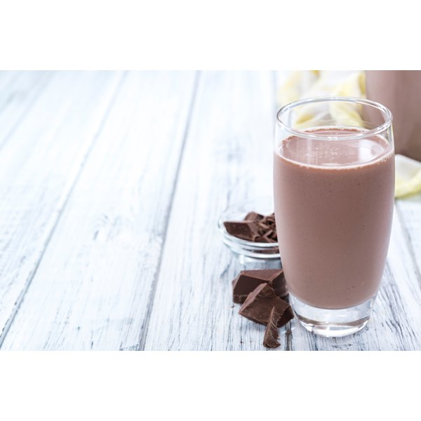 A glass of chocolate milk.