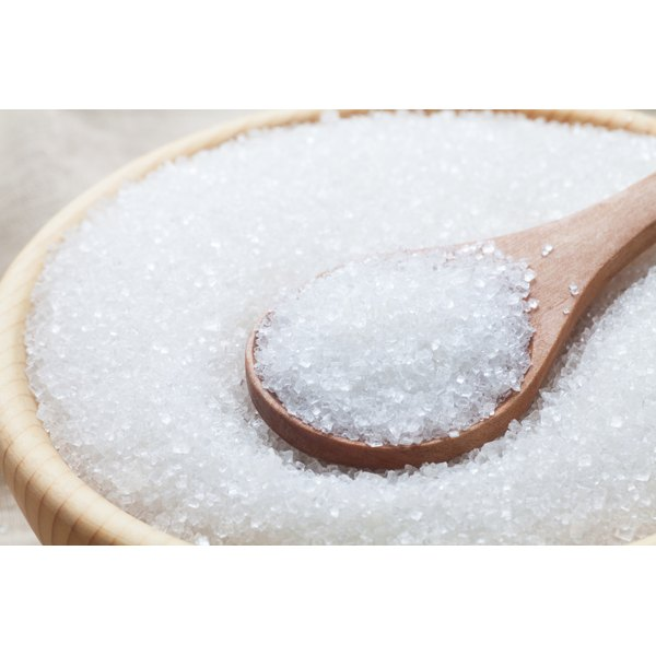 Granulated sugar in a wooden bowl.