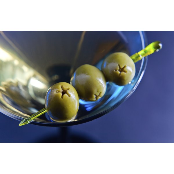 A dirty martini with olives.