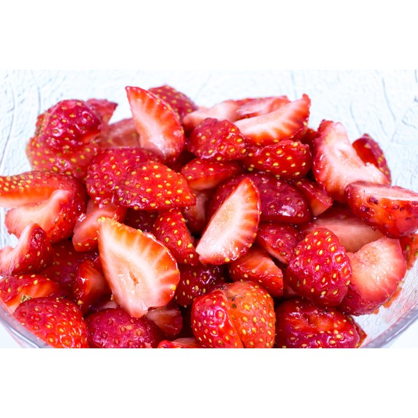 A plate of sliced strawberries.