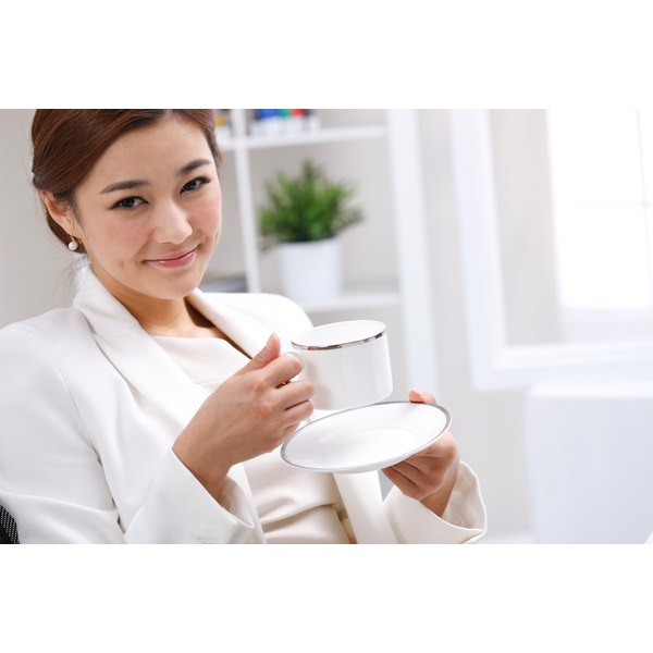 Young woman drinking a cup of coffee.