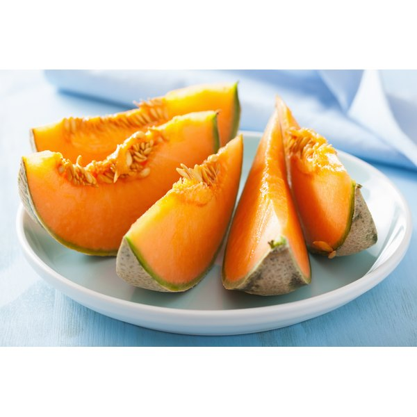A plate with cantaloupe wedges.
