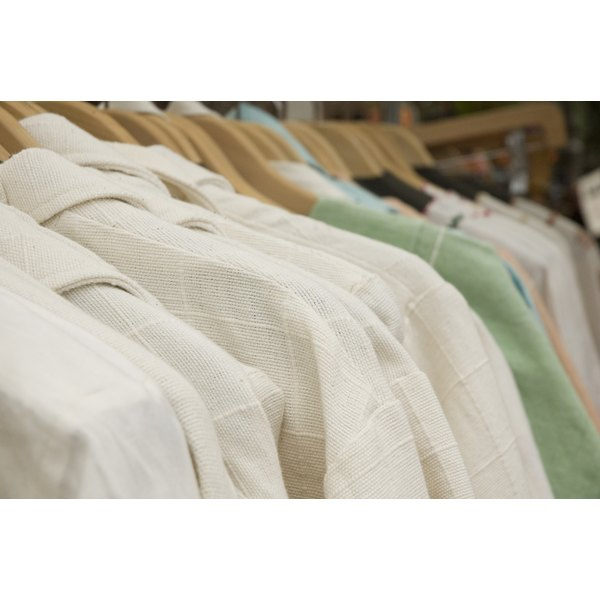 Close-up of linen shirts on hangers.