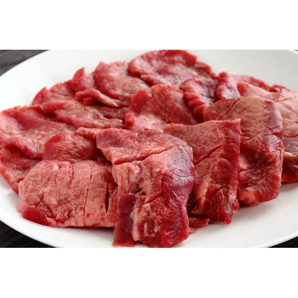 Sliced ox tongue on a plate.