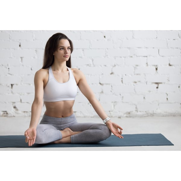Easy pose facilitates relaxation, easing stress-related digestive distress.