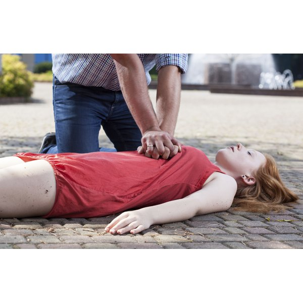 Man giving woman CPR