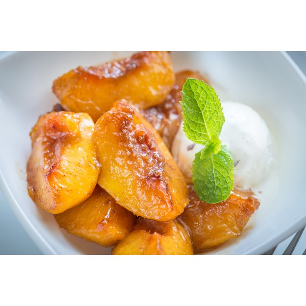 Carmelized peaches in a bowl with ice cream