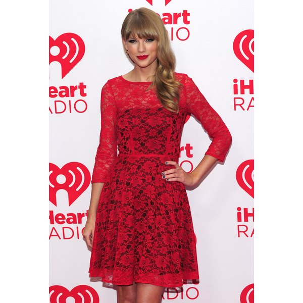 Taylor Swift looks ready to meet her Valentine in her romantic red dress.