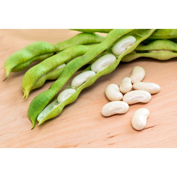 Lima beans on a wooden counter.