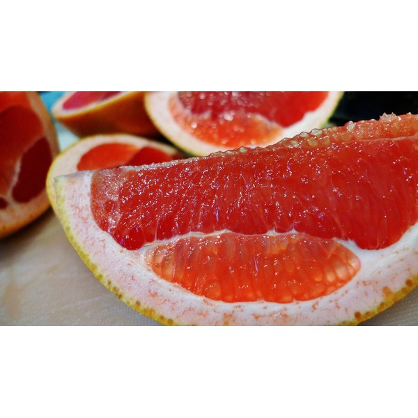A close up of a slice of grapefruit.