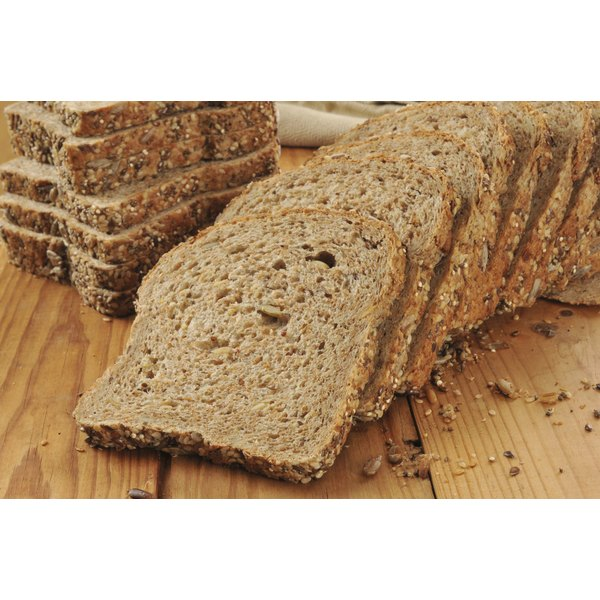 A sliced loaf of sprouted wheat bread.