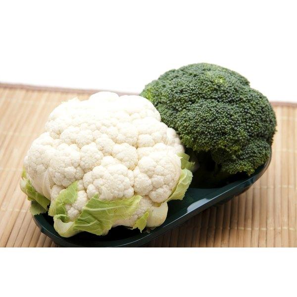 fresh broccoli and cauliflower shown on bowl in kitchen
