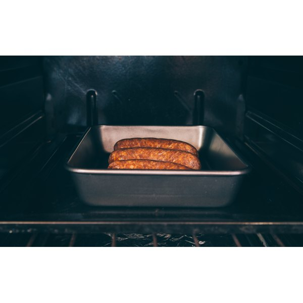 Turkey bratwurst cooking in the oven.