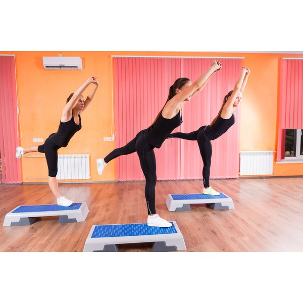 A group of women are exercising in an aerobics studio.