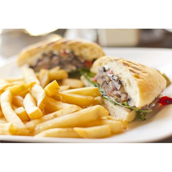 A portobello mushroom sandwich with fries.