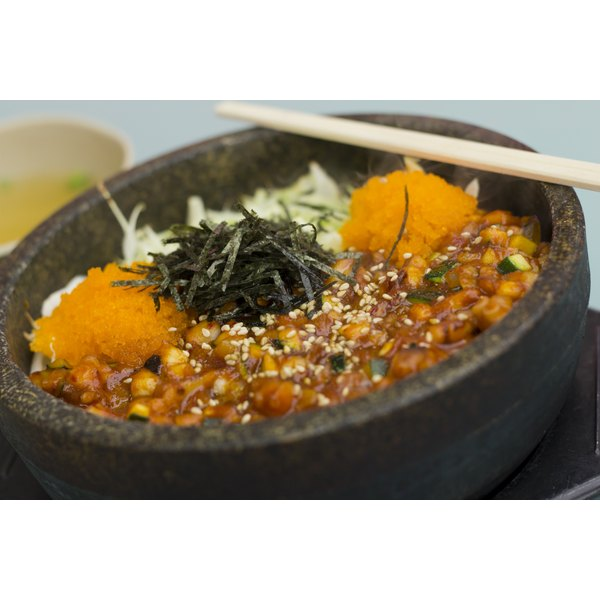A Korean seafood dish served in a clay pot.