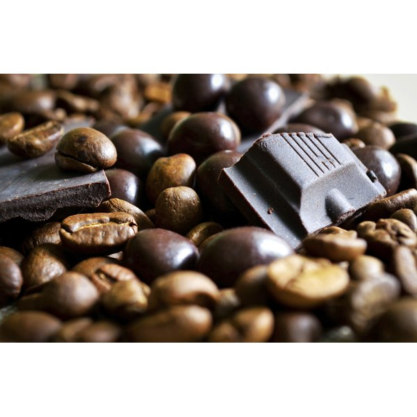 Chocolate covered coffee beans with pieces of dark chocolate and coffee beans.