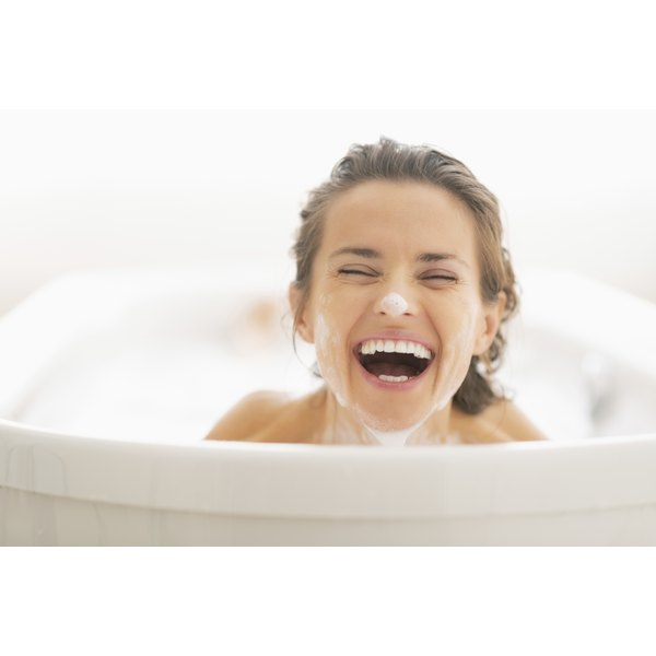 Portrait of young woman in the tub