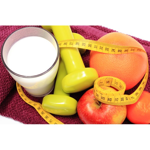 Milk, weights, a tape measure, an orange and an apple.