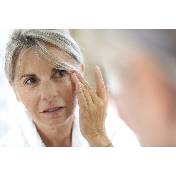 woman examine her wrinkles