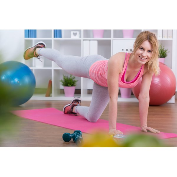 A woman is exercising at home.