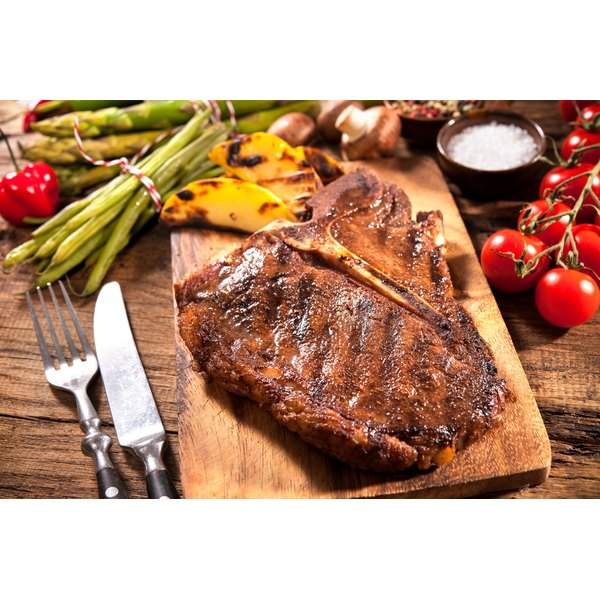 A large porterhouse steak on a cutting board.