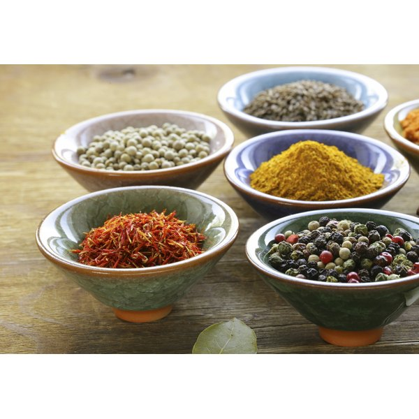 Assorted spices in ceramic dishes.