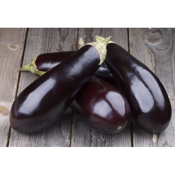 Eggplants on a wooden table.
