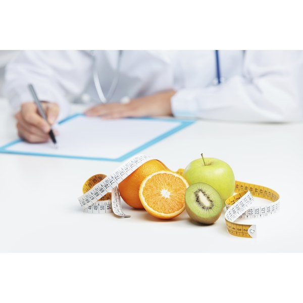 Fruit and a tapemeasure on a nutritionist's desk.