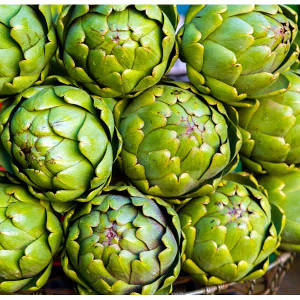 Fresh artichokes for sale at a market.