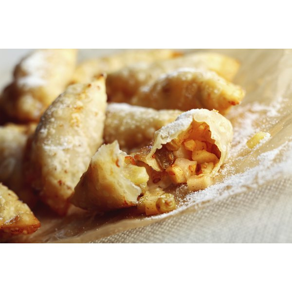 Fried apple pies dusted with powdered sugar.