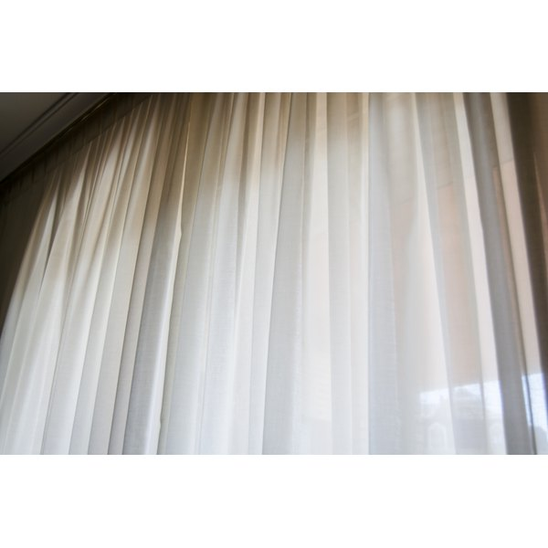 A window with white chiffon curtains.
