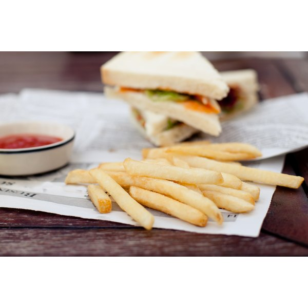 A white bread sandwich and french fries.